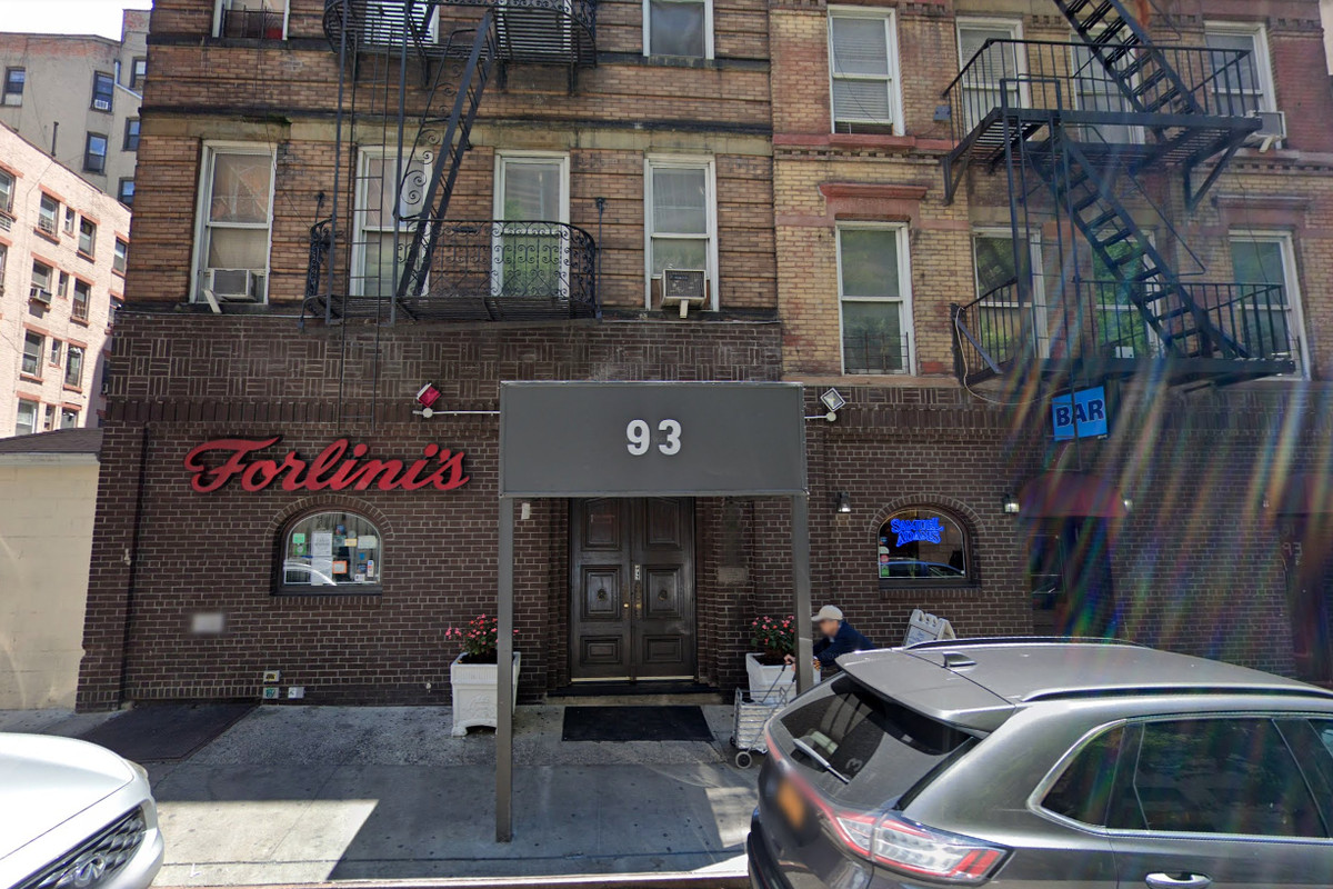"""The outside of a brick building with red, cursive letters that read """"Forlini's"""""""