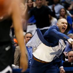 Brigham Young Cougars head coach Mark Pope yells after referees charged BYU with a blocking foul rather than charge Gonzaga with a charging foul at the Marriott Center in Provo on Saturday, Feb. 22, 2020.