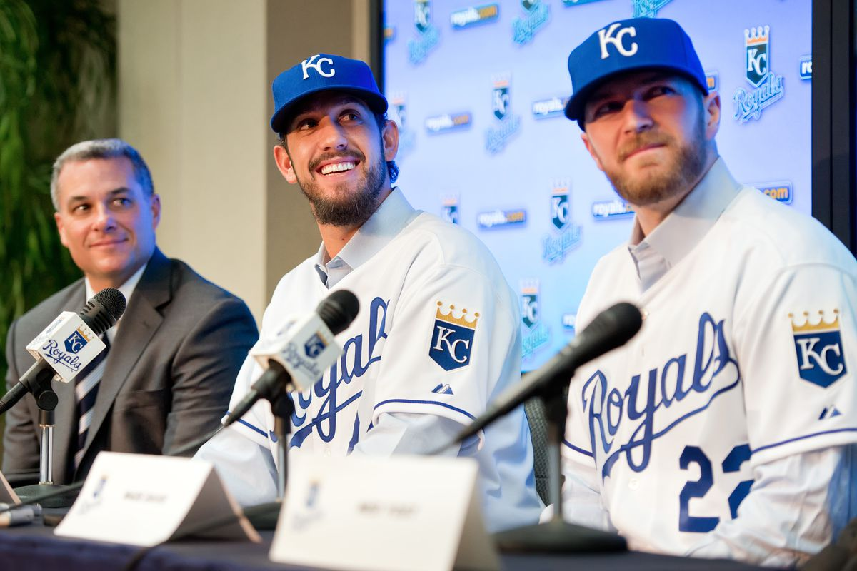 Kansas City Royals pitchers James Shields, center, and Wade Davis, right, speak to reporters during introductory news conference at Kauffman Stadium with Royals general manager Dayton Moore, at left, Wednesday, December 12, 2012, in Kansas City, Missouri.