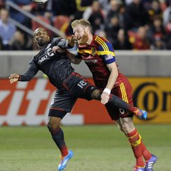 Real Salt Lake defender Nat Borchers (6) heads the ball over Toronto FC forward Jermain Defoe (18) during a game at Rio Tinto Stadium in Sandy on Saturday, March 29, 2014.