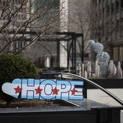 """A sign of """"hope"""" in Pioneer Court on Michigan Avenue near East Illinois Street during the coronavirus pandemic."""