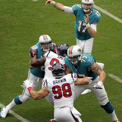 Miami Dolphins quarterback Ryan Tannehill (17) passes against the Houston Texans in the first quarter of an NFL football game on Sunday, Sept. 9, 2012, in Houston.