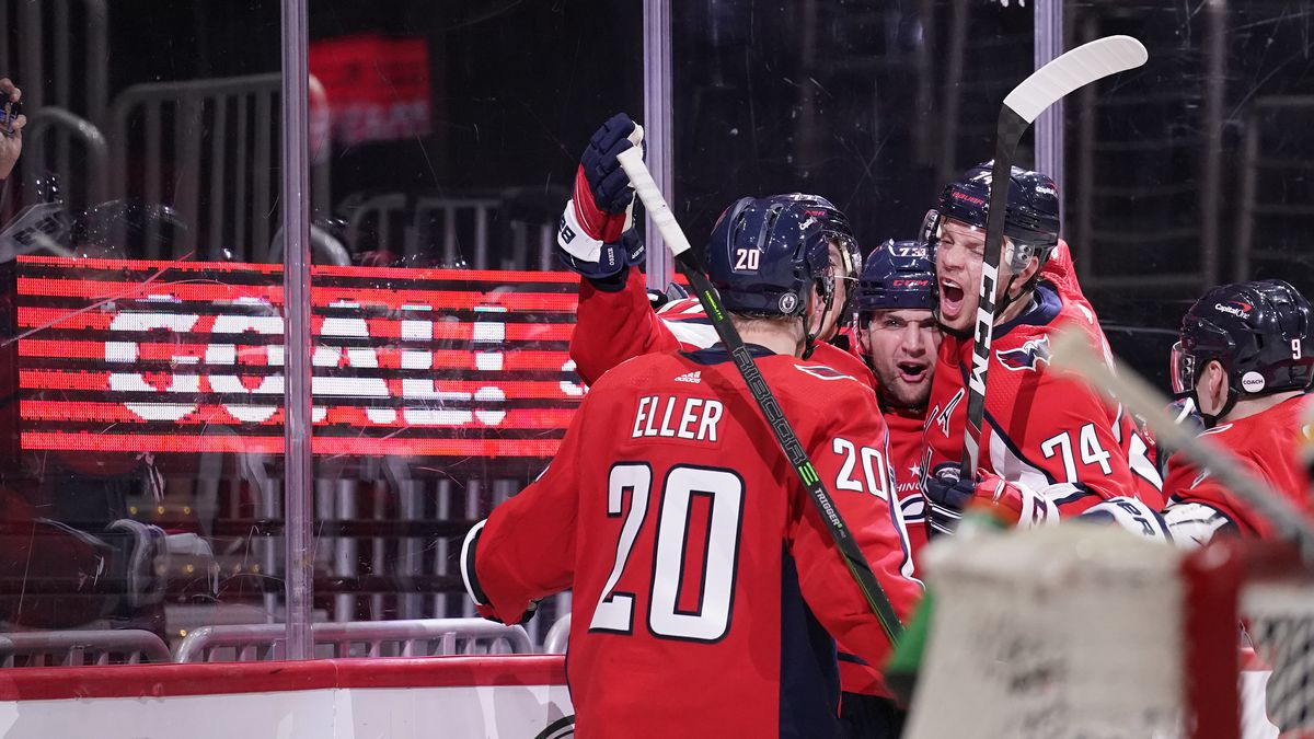 Conor Sheary #73 of the Washington Capitals celebrates with his teammates after scoring a goal against the Boston Bruins in the third period in Game Five of the First Round of the 2021 Stanley Cup Playoffs at Capital One Arena on May 23, 2021 in Washington, DC.