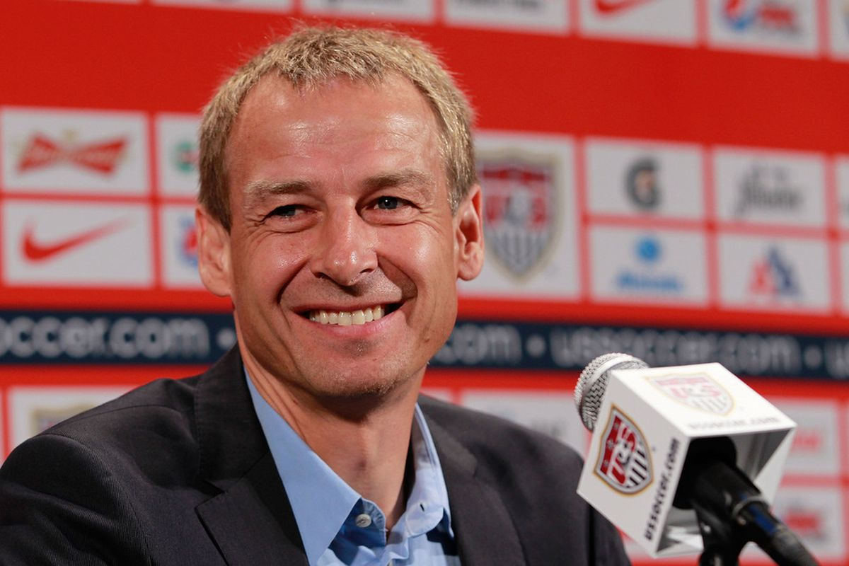 Teal Bunbury, CJ Sapong, and Graham Zusi will all have a chance to impress USMNT head coach Jurgen Klinsmann (above) when the January training camp starts today. (Photo by Chris Trotman/Getty Images)