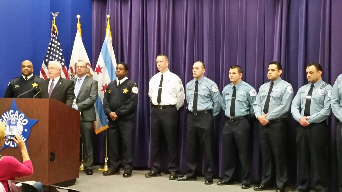 Chief of Patrol Eddie Johnson, far left, on Wednesday with Chief of Detectives Gene Roy and Sixth District officers at news conference to announce the arrest of Samuel Harviley, a repeat gun offender, in the shooting of an off-duty officer.   Chicago Poli