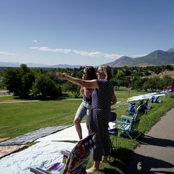 Hannah Grow and her mother, Sherlyn Tambasco, try to predict where the fireworks will appear while hanging out with family at Rock Canyon Park in Provo on Saturday, July 4, 2020.