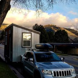 Ivor's tiny house, named Tad Cooper, is hitched up to his car and ready for a drive to a new destination.