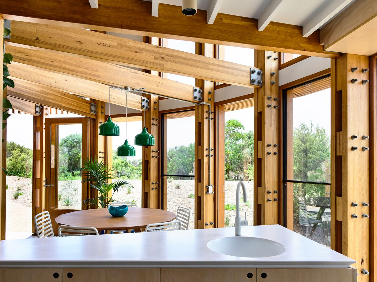Circular home with wood beam ceiling