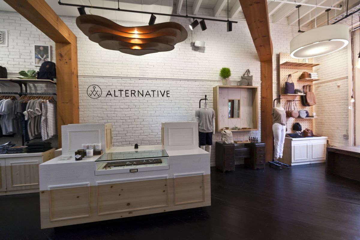 The front of the Alternative Apparel store, including the cash register, jewelry, and handbags