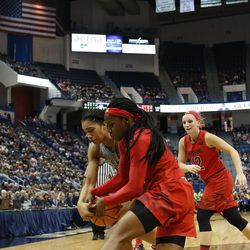 UConn�s Gabby Williams (15) fights with a Maryland player for a rebound.