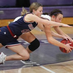Herriman's Kenlee Enger and Riverton's Morganne McCleary fight for the ball in Riverton on Thursday, Jan. 28, 2021.