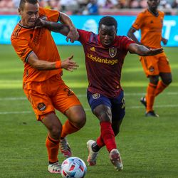 Real Salt Lake forward Anderson Julio, right, battles Houston Dynamo defender Sam Junqua for the ball as RSL and Houston play an MLS soccer game at Rio Tinto Stadium in Sandy on Saturday, June 26, 2021.