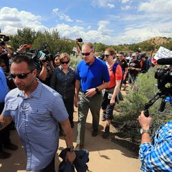 Interior Secretary Ryan Zinke walks to his vehicle after hiking to an overlook in the Butler Wash area of the Bears Ears National Monument to view ancient ruins on Monday, May 8, 2017.