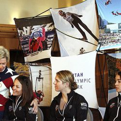 Deedee Corradini, USA President of Women's Ski Jumping, is joined with ski jumpers Lindsey Van, Abby Hughes and Sarah Hendrickson during a press conference celebrating the International Olympic Committee's decision to include women ski jumpers in the 2014 Sochi Winter Games on Wednesday, April 6, 2011.