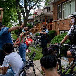 Youth activists dance in front of Chicago Board of Education President Miguel del Valle's home in Belmont Cragin to demand an end to police presence in schools, Wednesday afternoon, June 24, 2020. The Chicago Board of Education is set to decide whether to end Chicago Public Schools' $33 million contract with the Chicago Police Department and pull out police officers from schools.