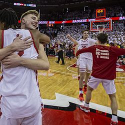 Aleem Ford and Tyler Wahl embrace one another while celebrating. The game capped off an emotional week for the team.