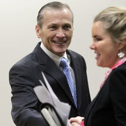 Martin MacNeill greets defense attorney Susanne Gustin before closing arguments in his murder trial in Provo's 4th District Court on Friday, Nov. 8, 2013. MacNeill is charged with murder in the 2007 death of his wife, Michele MacNeill.