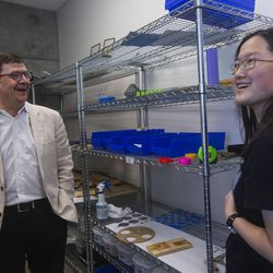 Troy D'Ambrosio, Lassonde Institute executive director, left, and student Tianxing Jin stand in the prototyping room with 3-D printers at the Lassonde Studios on the University of Utah campus in Salt Lake City on Friday, June 23, 2017. Jin manages the room while attending school, majoring in philosophy and computer science.