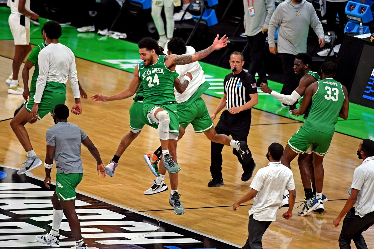 The North Texas Mean Green celebrates beating the Purdue Boilermakers in the first round of the 2021 NCAA Tournament at Lucas Oil Stadium.