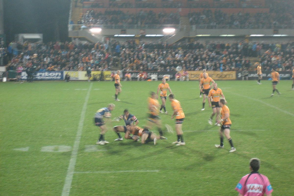 Hard-hitting and fast rugby action in Australia, photo by Jose Romero