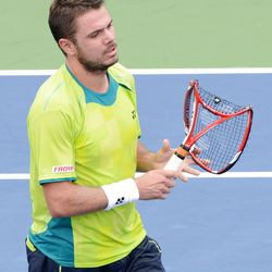 Stanislas Wawrinka of Switzerland holds a broken racket during his loss to Serbia's Novak Djokovic in the quarterfinals round of play at the 2012 US Open tennis tournament,  Wednesday, Sept. 5, 2012, in New York. (AP Photo/Henny Ray Abrams)