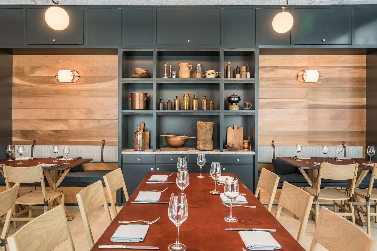 A private dining area with blonde wood accents at a new restaurant.