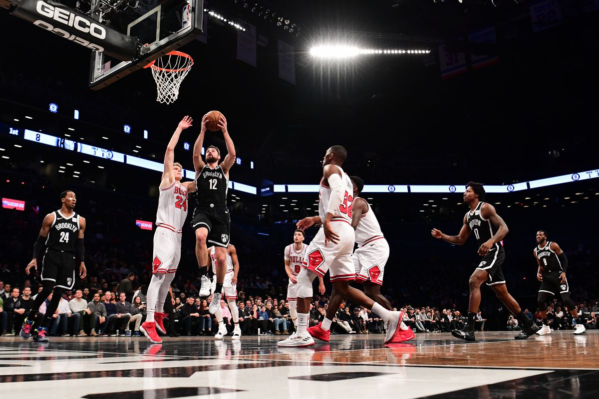 Joe Harris of the Brooklyn Nets attempts a layup against the Chicago Bulls