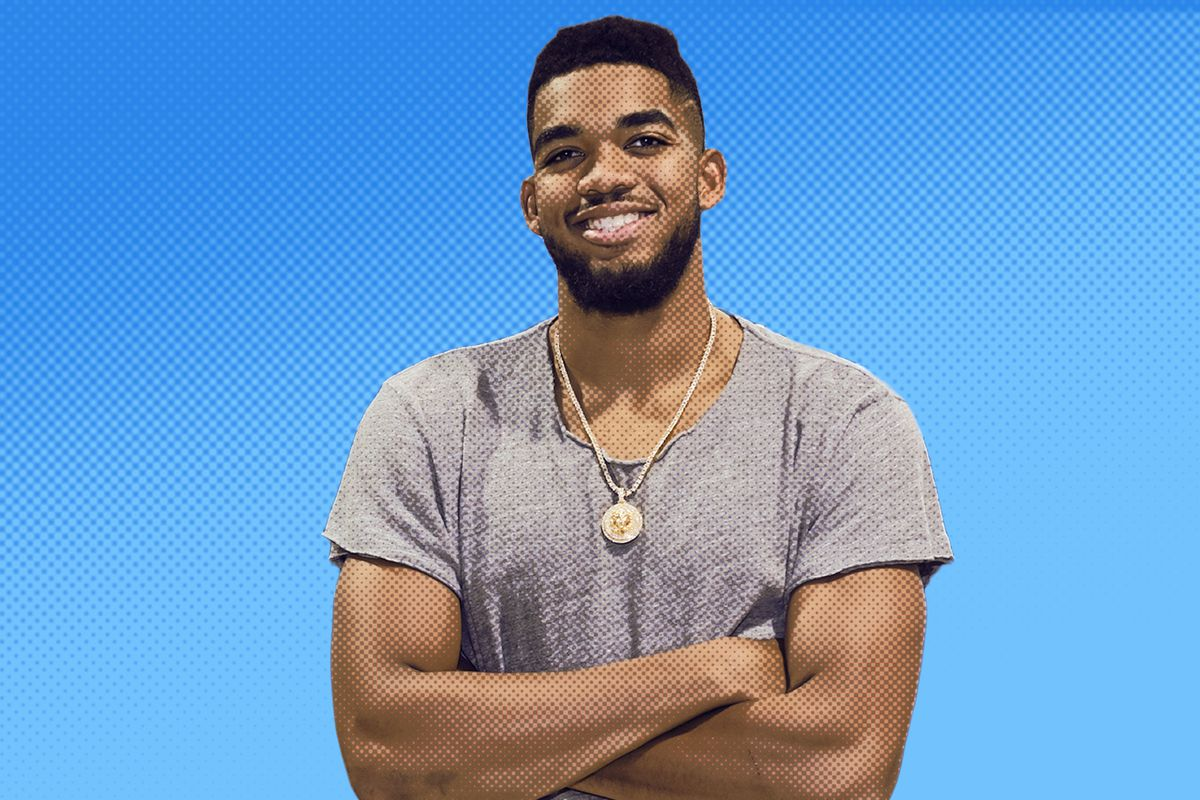 Karl-Anthony Towns smiling with his arms crossed