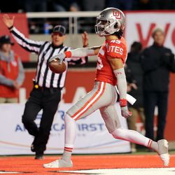 Utah Utes wide receiver Samson Nacua (45) celebrates after scoring a touchdown as Utah and UCLA play a college football game in Salt Lake City at Rice-Eccles Stadium on Saturday, Nov. 16, 2019. Utah won 49-3.