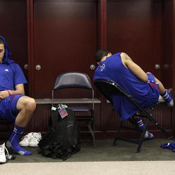 Kansas guard Christian Garrett, left, and guard Niko Roberts (20) react in the locker room after their 67-59 loss to Kentucky in the NCAA Final Four tournament college basketball championship game Monday, April 2, 2012, in New Orleans.