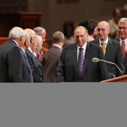 President Thomas S. Monson, with counselors President Henry B. Eyring and President Dieter F. Uchtdorf enter the morning session of the 183rd Semiannual General Conference of the Church of Jesus Christ of Latter-day Saints Sunday, Oct. 6, 2013, in Salt Lake City.