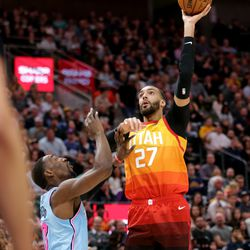 Utah Jazz center Rudy Gobert (27) pushes up a shot over Miami Heat forward Bam Adebayo (13) as the Utah Jazz and the Miami Heat play in an NBA basketball game at Vivint Smart Home Arena in Salt Lake City on Wednesday, Feb. 12, 2020.