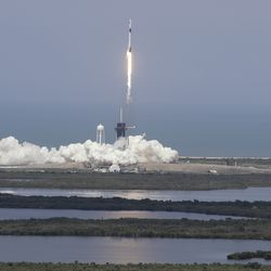 The SpaceX Falcon 9 and the Crew Dragon capsule, with NASA astronauts Bob Behnken and Doug Hurley onboard, lifts off Saturday, May 30, 2020, at the Kennedy Space Center in Cape Canaveral, Fla.