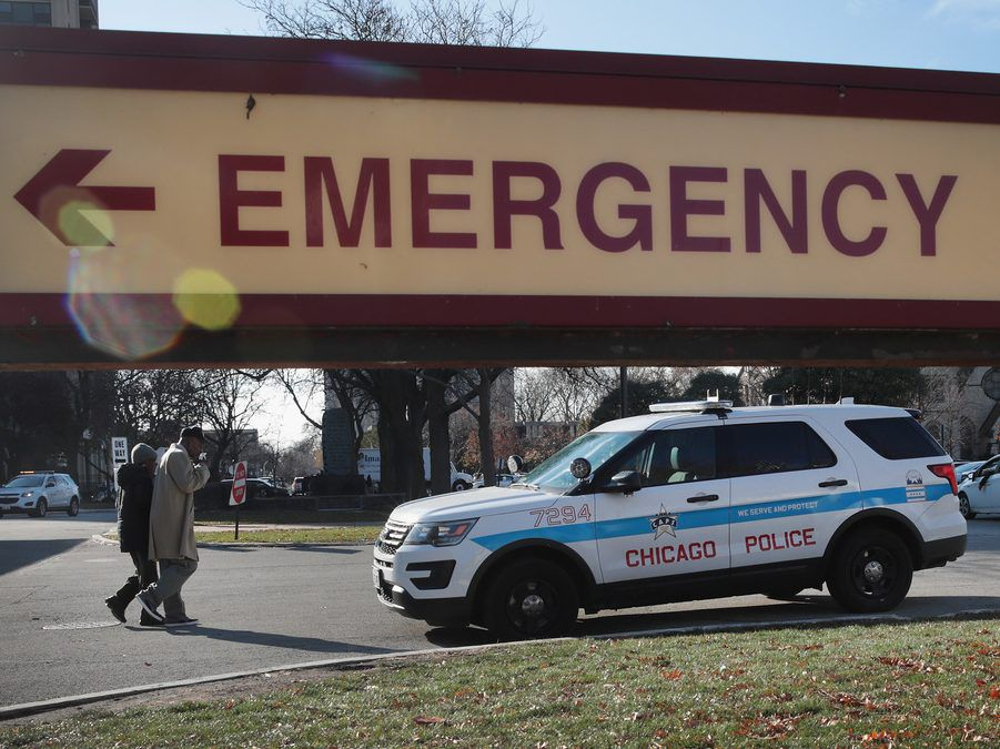A police vehicle sits outside of Mercy Hospital where four people were shot and killed Monday. | Scott Olson/Getty Images