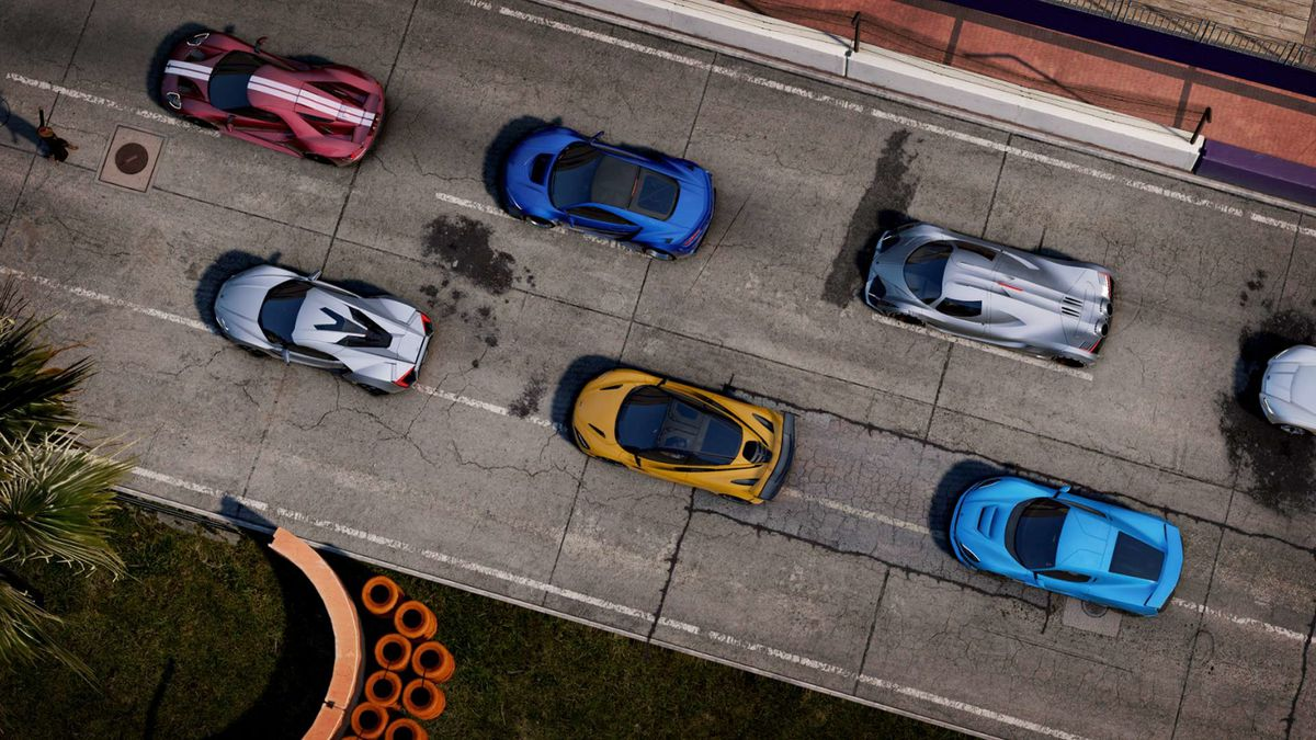 A series of cars line up to race