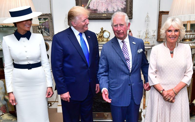 President Donald Trump (second left) and First Lady Melania Trump (L) pose for a photograph with their hosts Prince Charles (2R) and Camilla, Duchess of Cornwall, before taking tea at Clarence House in London on June 3, 2019.