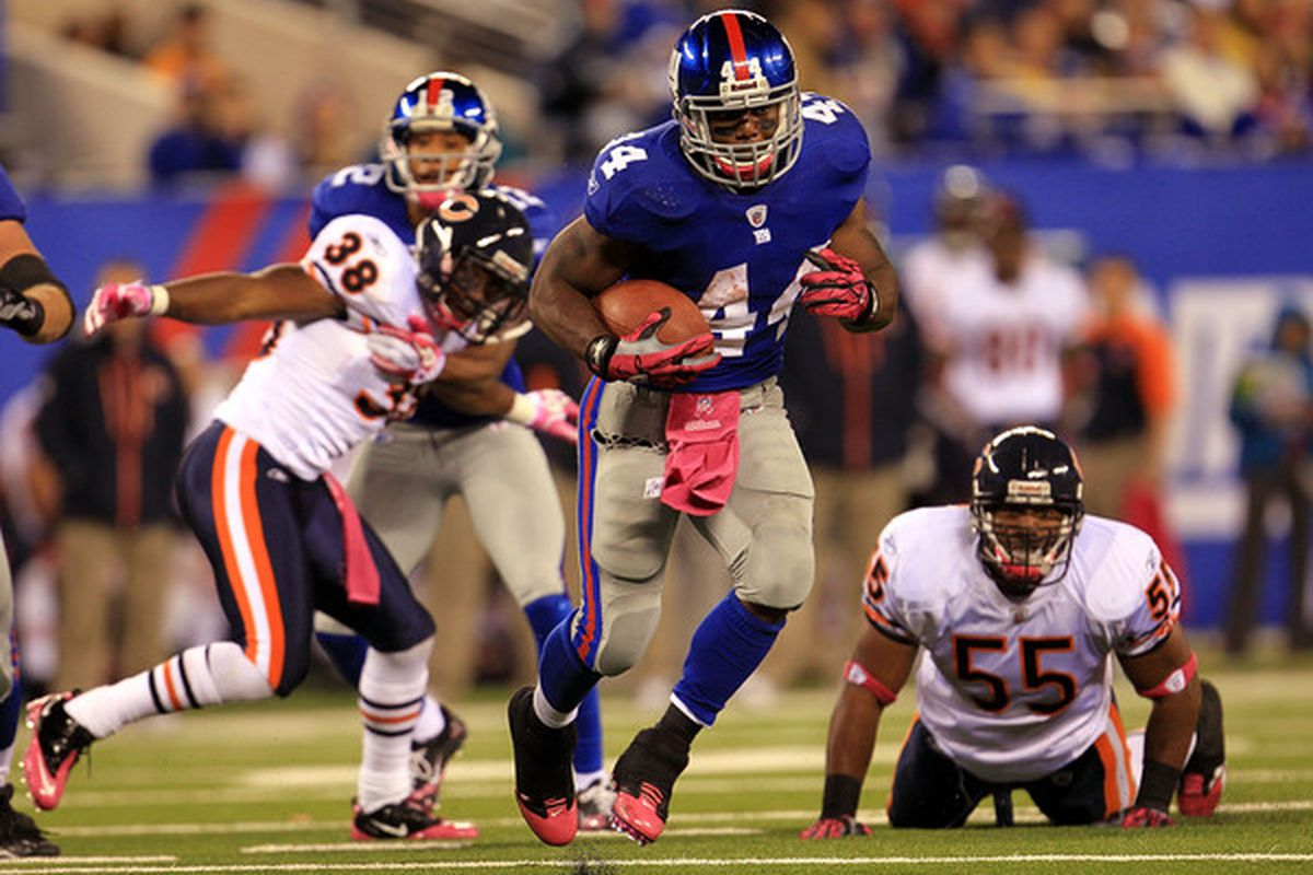 EAST RUTHERFORD NJ - OCTOBER 03:  Ahmad Bradshaw #44 of the New York Giants runs the ball against the Chicago Bears at New Meadowlands Stadium on October 3 2010 in East Rutherford New Jersey.  (Photo by Chris McGrath/Getty Images)