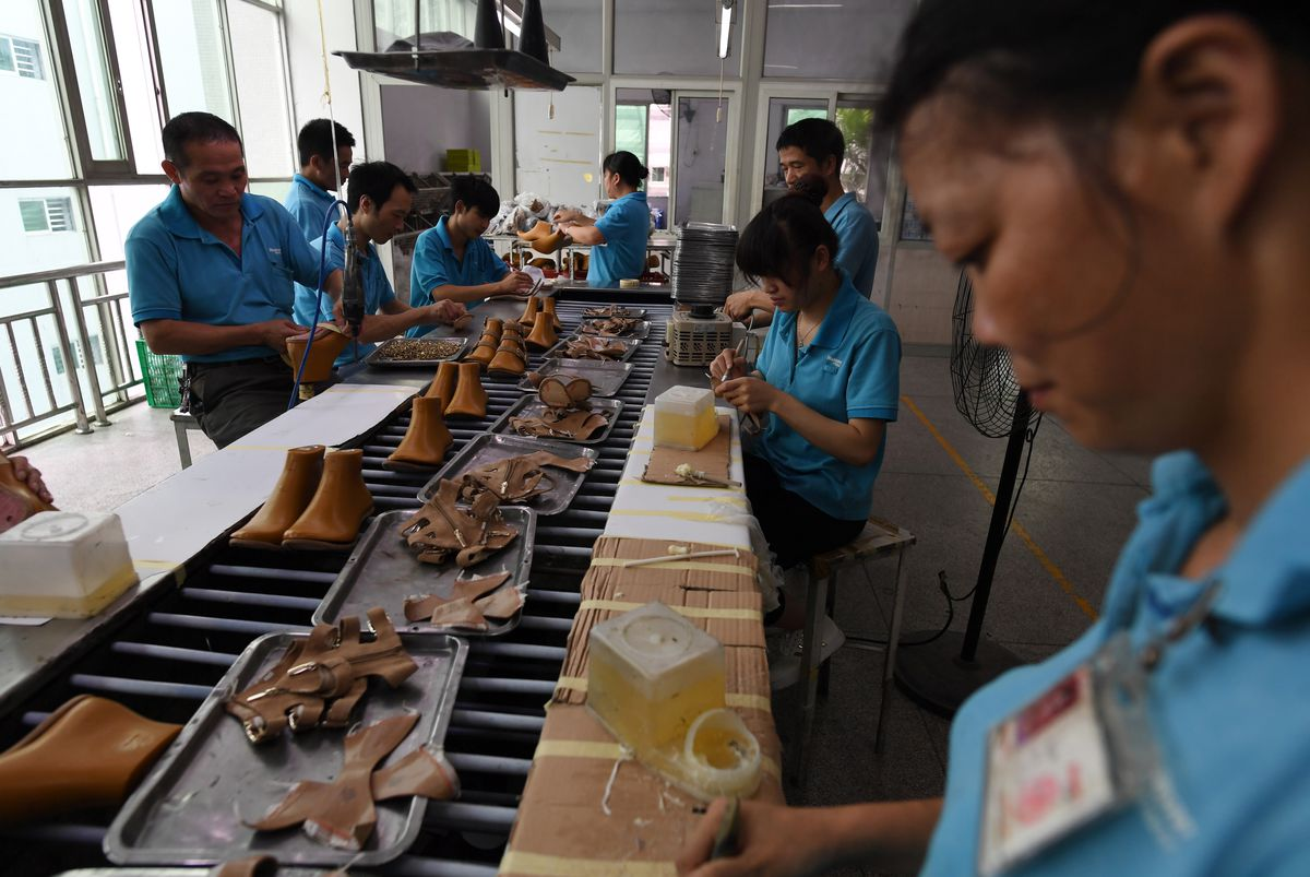 Workers on the production line at the Huajian shoe factory. Photo: Greg  Baker/Getty Images