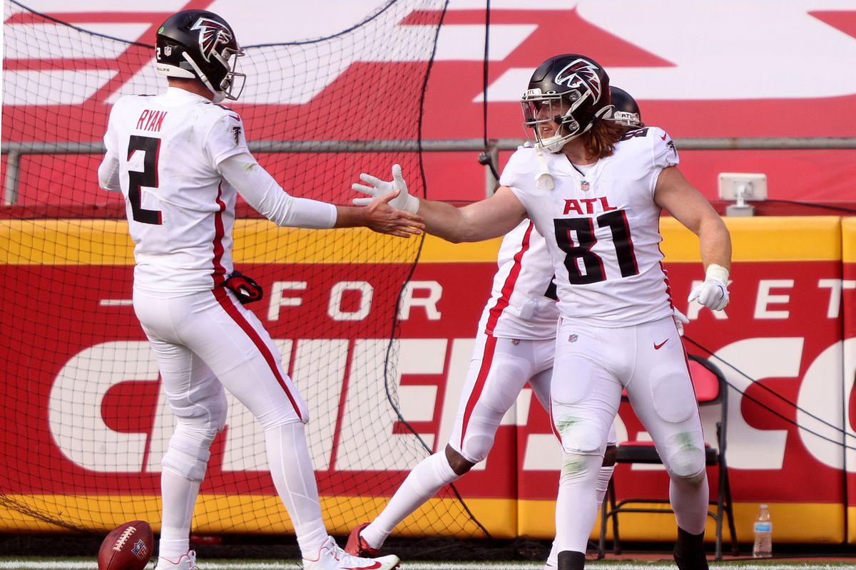 Matt Ryan #2 and Hayden Hurst #81 of the Atlanta Falcons celebrate their touchdown against the Kansas City Chiefs during the second quarter at Arrowhead Stadium on December 27, 2020 in Kansas City, Missouri.