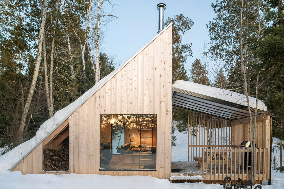 Timber cabin in the snow