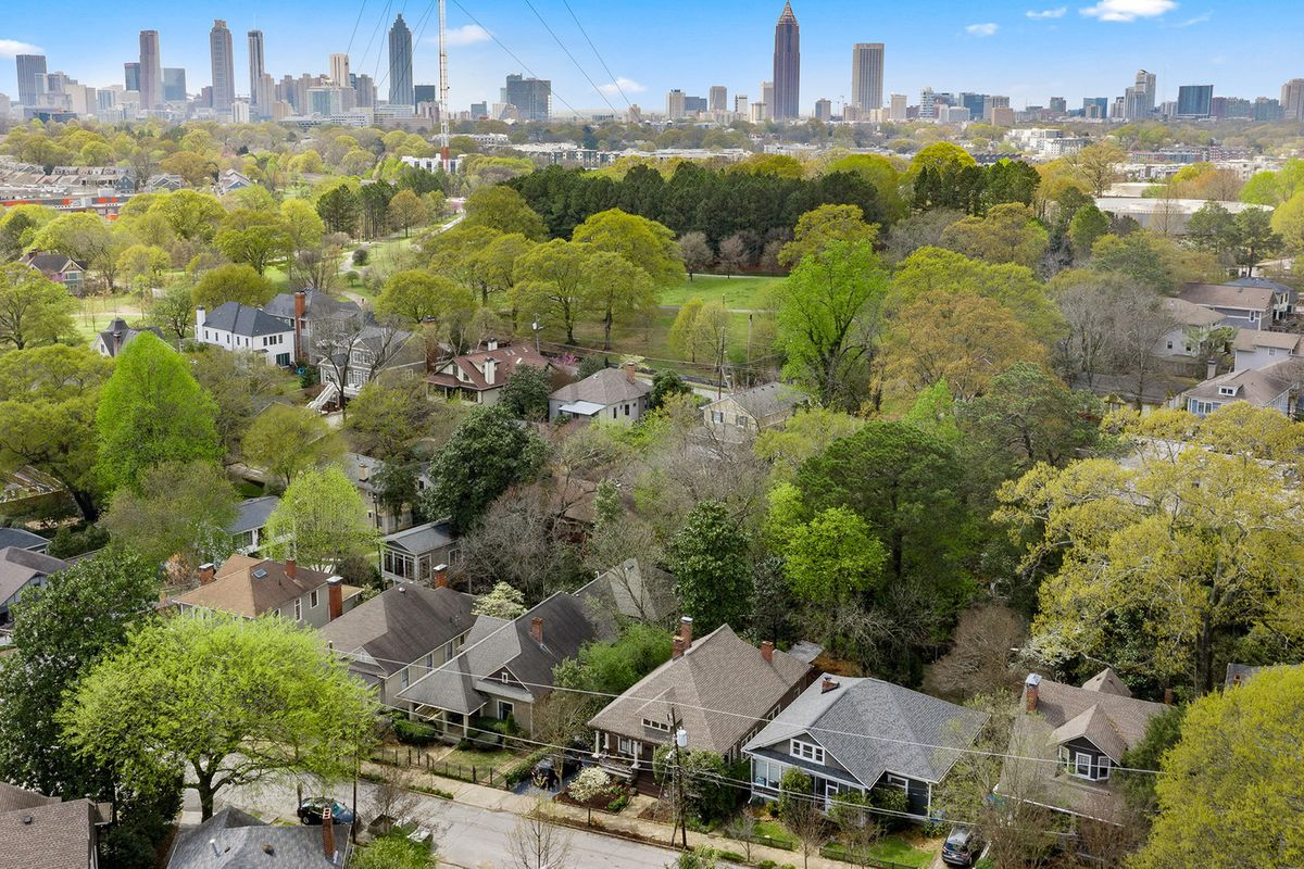An aerial view of a city in spring with trees.