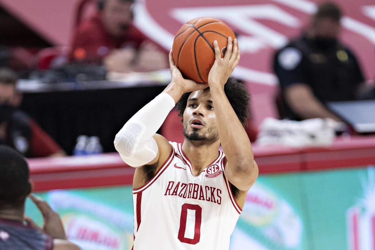 Justin Smith #0 of the Arkansas Razorbacks shoots a jump shot during a game against the Texas A&M Aggies at Bud Walton Arena on March 06, 2021 in Fayetteville, Arkansas. The Razorbacks defeated the Aggies 87-80.