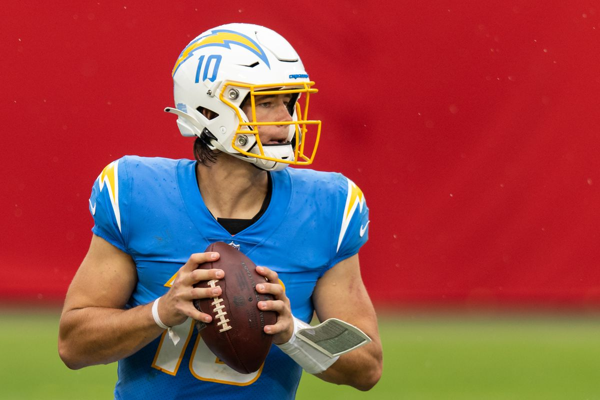 Justin Herbert #10 of the Los Angeles Chargers looks to pass during the third quarter of a game against the Tampa Bay Buccaneers at Raymond James Stadium on October 04, 2020 in Tampa, Florida.