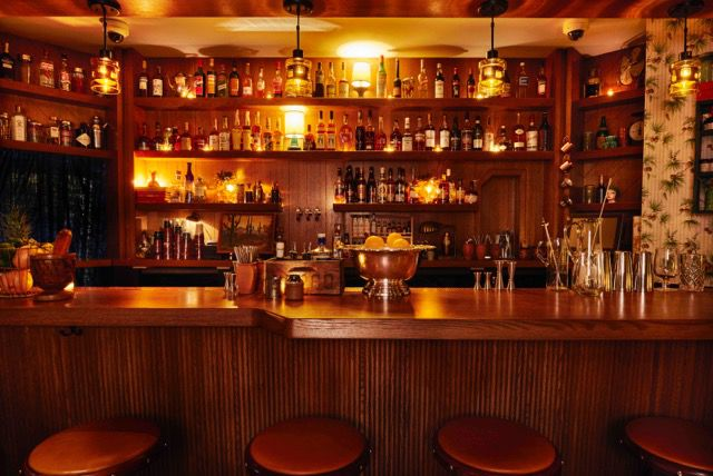 A dimly-lit bar with stools.