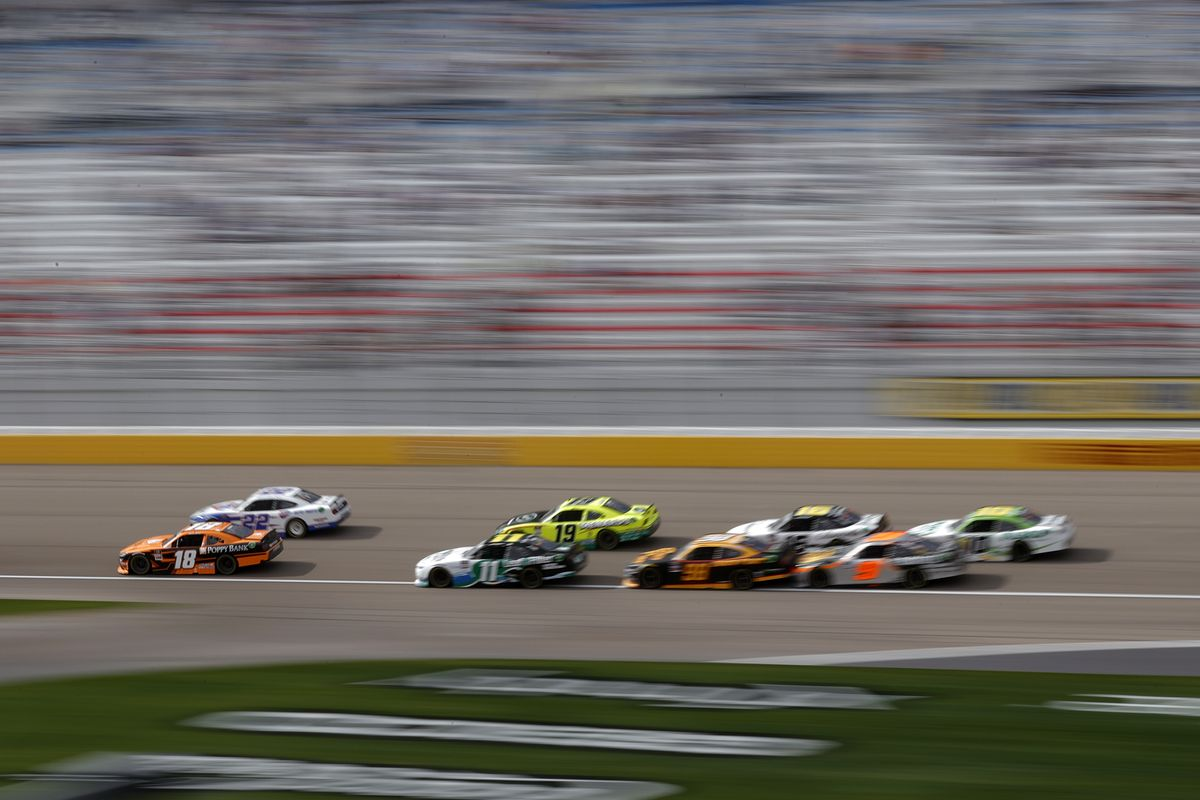 Daniel Hemric, driver of the #18 Poppy Bank Toyota, and Austin Cindric, driver of the #22 Carquest Auto Parts Ford, lead the field during the NASCAR Xfinity Series Alsco Uniforms 300 at The Bullring at Las Vegas Motor Speedway on March 06, 2021 in Las Vegas, Nevada.