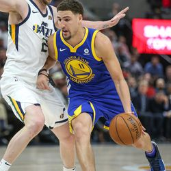 Golden State Warriors guard Klay Thompson (11) drives against Utah Jazz forward Joe Ingles (2) during the game at Vivint Arena in Salt Lake City on Tuesday, April 10, 2018.