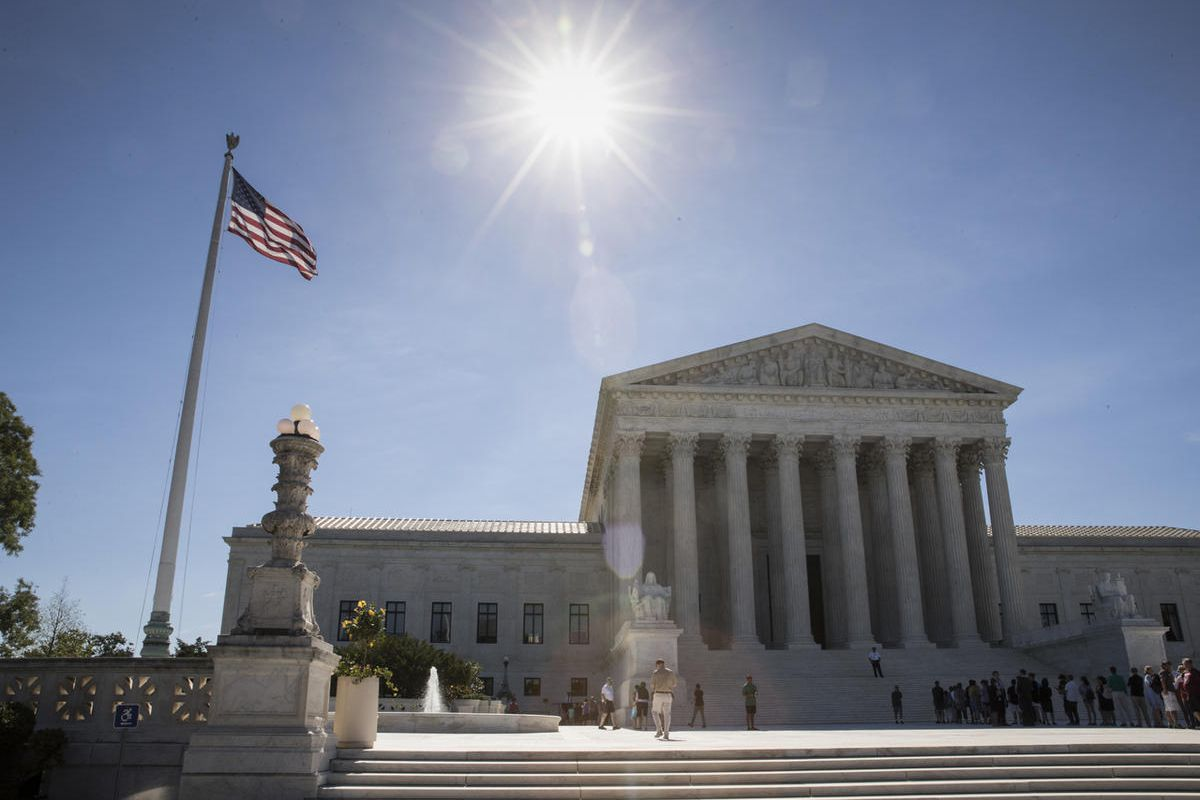 People visit the Supreme Court in Washington, Monday, June 26, 2017, as justices issued their final rulings for the term, in Washington. The high court is letting a limited version of the Trump administration ban on travel from six mostly Muslim countries