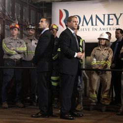 Two Secret Service agents stand watch during a campaign rally for Republican presidential candidate, former Massachusetts Gov. Mitt Romney at Consol Energy Research and Development Facility in South Park Township, Pa., Monday, April 23, 2012.