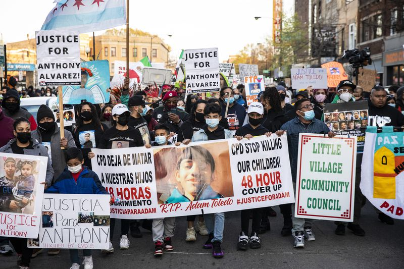 Protesters march on April 16, 2021 near Mayor Lori Lightfoot's home.