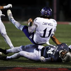 Weber State Wildcats quarterback Stefan Cantwell is tackled by Southern Utah Thunderbirds linebacker Mike Needham during NCAA football in Cedar City on Saturday, Dec. 2, 2017.
